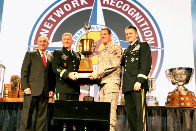 Chief Warrant Officer 4 Michael Siler, 1st Battalion, 160th Special Operations Aviation Regiment (Airborne), accepts the Michael J. Novosel Army Aviator of the Year Award during the 2015 Army Aviation Mission Solutions Summit, March 30-31, at the Gaylord Opry Convention Center in Nashville, Tenn.