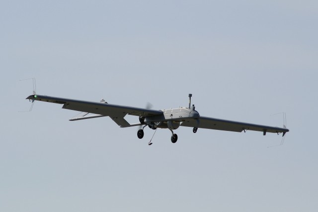The RQ-7Bv2 (Tactical Common Data Link) Shadow unmanned aircraft system soars in the air.