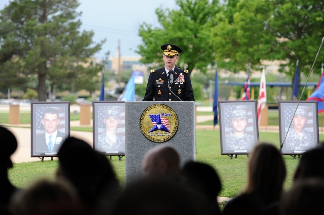 Fort Hood presents Purple Hearts, medals to shooting victims, Families
