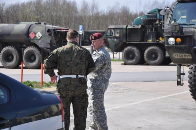 Polish Military Police meet with paratroopers from the 173rd Airborne Brigade Support Battalion at the German-Polish border April 9, 2015 to provide escorts for the paratroopers' ground convoy through Poland. The convoy moved from their home station in Vicenza, Italy to Yavoriv, Ukraine to deliver training equipment for the brigade during its training of the newly formed Ukrainian National Guard as part of Operation Fearless Guardian.