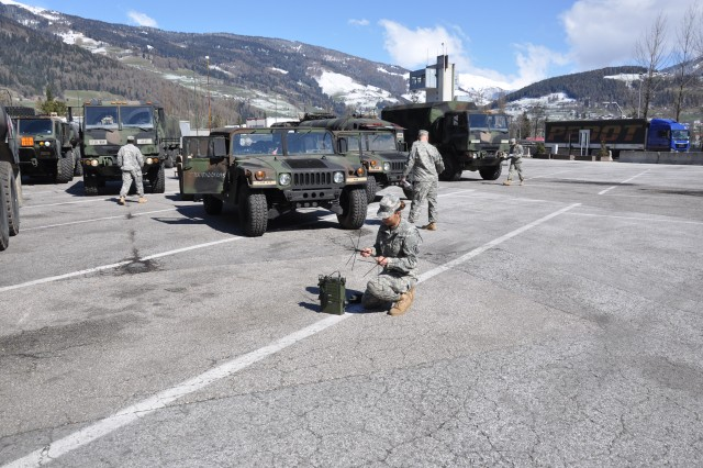 Paratroopers from the 173rd Airborne Brigade Support Battalion stop to check equipment and send a satellite transmission April 7, 2015 near Trento, Italy during a several day ground movement. The convoy moved from their home station in Vicenza to Yavoriv, Ukraine to deliver training equipment for the brigade during its training of the newly formed Ukrainian National Guard as part of Operation Fearless Guardian.