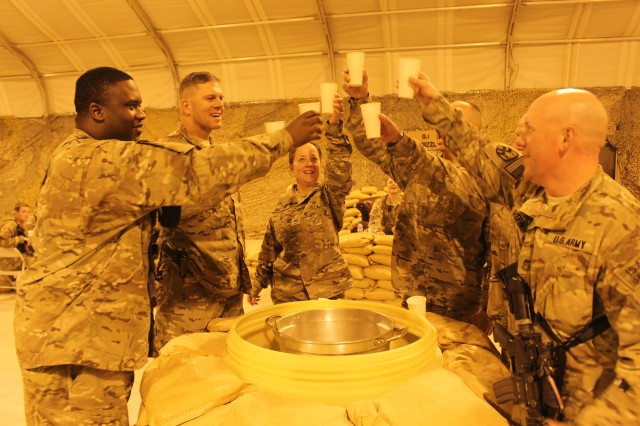 Senior leaders attending the 17th Combat Sustainment Support Battalion Tactical Dining-In toast the grog before taking a drink 23 Oct., 2014, at Bagram Airfield, Afghanistan.