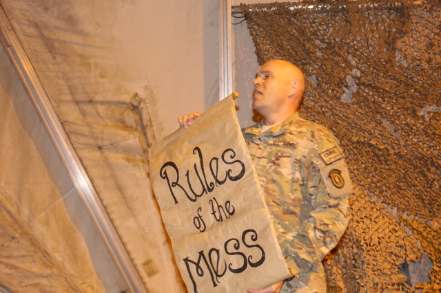 Maj. Bart Lajoie, Mr. Vice for the 17th Combat Sustainment Support Battalion Tactical Dining-In, reads the Rules of the Mess to the event's attendees 23 Oct., 2014, at Bagram Airfield, Afghanistan.