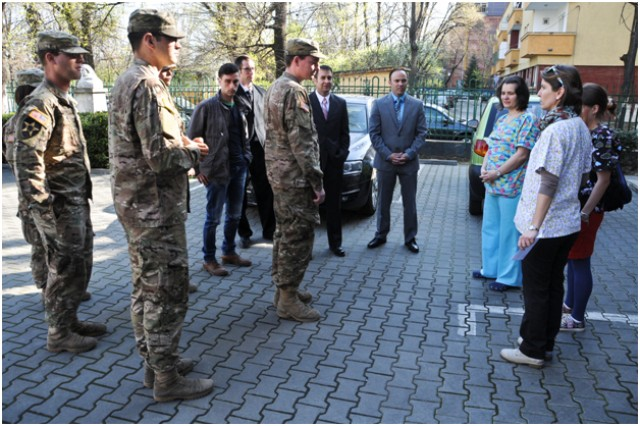 Combat Medics assigned to Headquarters and Headquarters Troop, 2nd Squadron, 2nd Cavalry Regiment, visit with medical staff at the Institute of Mother and Childcare in Bucharest, Romania, Apr. 10, 2015.