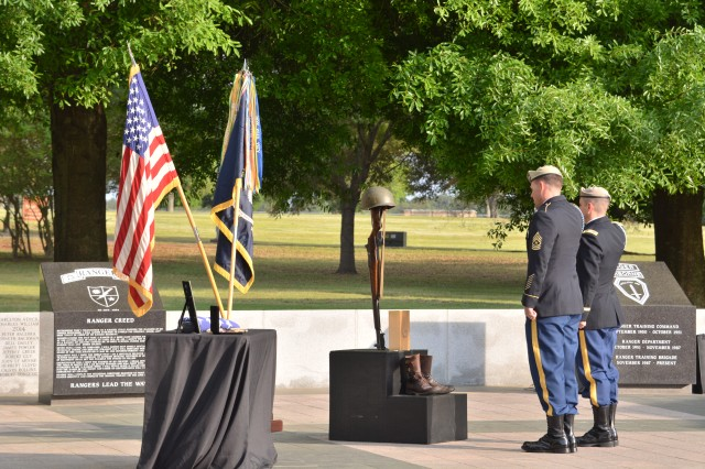 Sgt. Maj. William Pouliot, operations sergeant major for the 75th Ranger Regiment and Col. Peter Shull, deputy commander for the 75th Ranger Regiment pay their final respects at the Ranger  Raymond Noel Dye memorial ceremony held April 9, 2015, at the Ranger Memorial, Fort Benning, Ga.