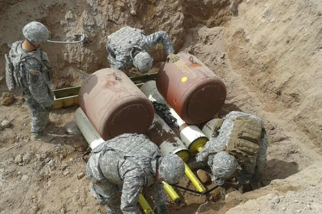 Soldiers, from the 741st Explosive Ordnance Disposal Company, prepare to destroy ordnance at New Mexico Tech's Energetic Materials Research Testing Center in Socorro, New Mexico.