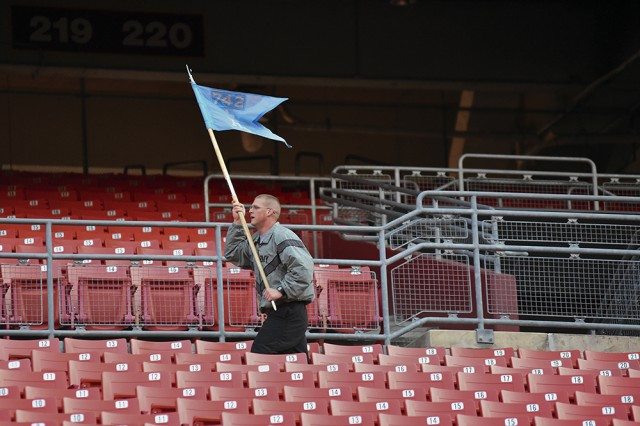 Capt. Joshua Gompert carries the guidon as he leads his fellow Soldiers in a lap around the lower bowl of FedExField as the 742nd MI Battalion, 704th MI Brigade, conducts physical fitness training at the home of the Washington Redskins, April 2