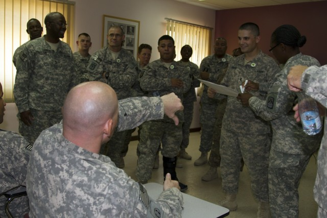 Sgt. Frank Koulalis rejects a law proposed by 1st Lt. David Parks during an exercise involving power and social dynamics in the military during the Equal Opportunity Leaders' Course at Camp Arifjan, Kuwait, July 24, 2015.