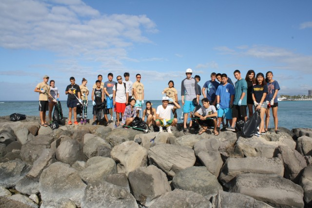 HONOLULU, Hawaii (April 11, 2015) -- More than 40 volunteers from the U.S. Army Corps of Engineers partnered with local JROTC students and others to clean up Waikiki Beach April 11 as part of Earth Month 2015. Over 20 volunteers from the Punahou Junior ROTC program (which includes cadets from other area high schools and some home-schooled students) joined over 20 Corps employees and their friends and families to clean up the beach and berm area at the Corps' Pacific Regional Visitor Center (RVC) at Fort DeRussy in Waikiki.