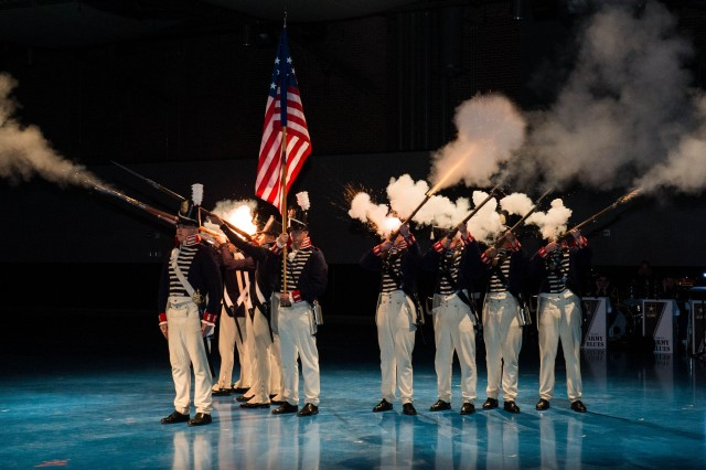 Members of The Old Guard fire a volley during a special Twilight Tattoo on Joint Base Myer-Henderson Hall, Va., April 14, 2015.