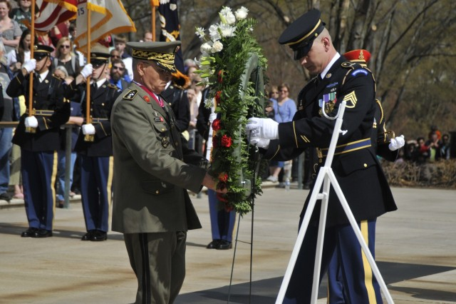 Tunisian army Chief of Staff Brig. Gen. Ismail Fathalli lays a wreath at the Tomb of the Unknown Soldier in Arlington National Cemetery April 13.