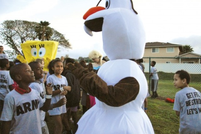 Olaf is met with enthusiastic admiration and excitement as military families gather together to celebrate the annual PT in the Park event for the Month of the Military Child held at Schofield School Age Center, April 7.