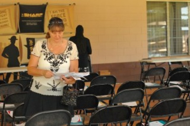 Mary Kay McGlothlin, Army Family Team Building assistant volunteer program manager, distributes informational flyers at a gathering of noncommissioned officers at the NCO Academy, Schofield Barracks, April 13.