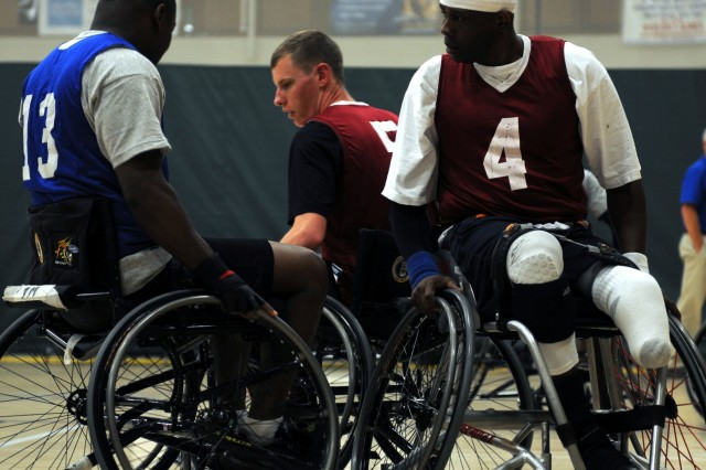 Spc. Terry L. Cartwright, an infantryman from the Fort Belvoir Warrior Transition Unit, uses his wheelchair to block a player from the opposing team during the Wheelchair Basketball championship game at the 2015 Army Trials on Fort Bliss, March 31, 2015. The Army Trials helps determine which Army athletes compete on the Department of Defense competition Army Team. (Photo by Sgt. Jessica R. Littlejohn/24th Press Camp Headquarters)