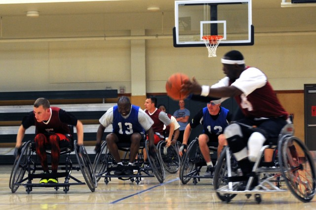 Spc. Terry L. Cartwright, an infantryman from the Fort Belvoir Warrior Transition Unit, races down the court during the Wheelchair Basketball championship game at the 2015 Army Trials on Fort Bliss, March 31, 2015. The Army Trials helps determine which Army athletes compete on the Department of Defense competition Army Team. (Photo by Sgt. Jessica R. Littlejohn/24th Press Camp Headquarters)