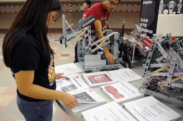 Jennifer Arreola, 18, and Felipe Carlos, 15, from El Dorado High School competed in the second Five Star Innovation Cup STEM Competition on Fort Bliss, March 21. Arreola and Carlos are members of the El Paso RoboAzTechz team, which won the Robotic Team Award for the second year in a row. (Photo by Sgt. Jessica R. Littlejohn/24th Press Camp Headquarters)