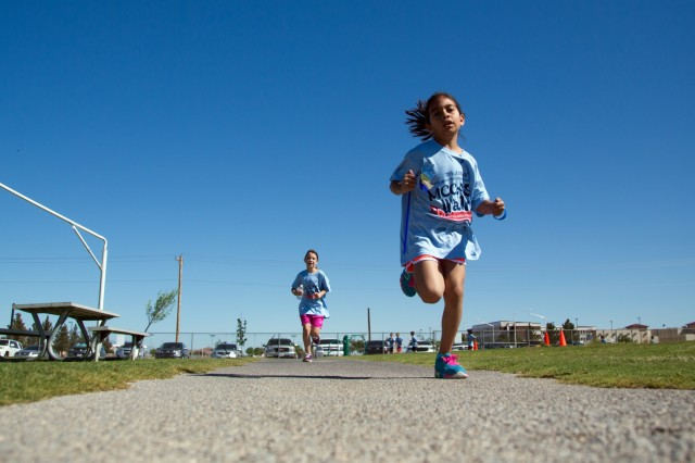 Children, Fort Bliss, Texas, run the 11th Annual Military Child, Child Abuse, Sexual Assault 2-mile awareness walk and family day, at Biggs Park on Fort Bliss, Texas, April 11, 2015. (U.S. Army photo by Sgt. Marcus Fichtl, 24th Press Camp)