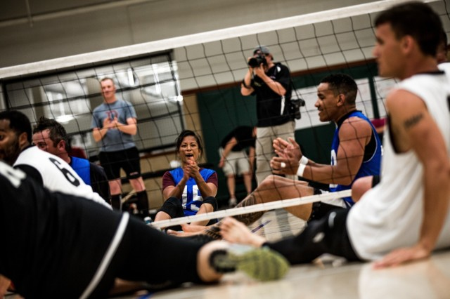 Sgt. Madeleine Morales, Waipahu, Hawaii, native, Army Trials athlete, Warrior Transition Unit, cheers after a point during a game of seated volleyball as part of the Army Trials, Fort Bliss Texas, April 1, 2015. The Army Trials showcase the resilient spirit of wounded, ill and injured Soldiers and veterans. Participants in Army Trials include athletes with spinal cord injuries, traumatic brain injuries, visual impairments, serious illnesses and amputations. The results of the games help determine which Army athletes compete on the Department of Defense level Army competition team. Morales fights PTSD she sustained from a deployment to Iraq. (U.S. Army photo by Sgt. Marcus Fichtl, 24th Press Camp)