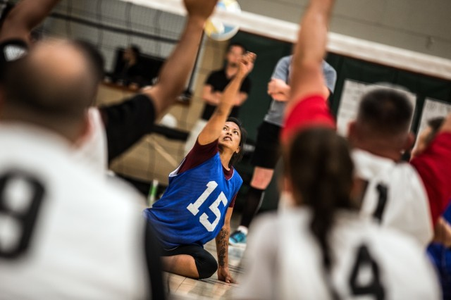 Sgt. Madeleine Morales, Waipahu, Hawaii, native, Army Trials athlete, Warrior Transition Unit, spikes a volleyball during a game of seated volleyball as part of the Army Trials, Fort Bliss Texas, April 1, 2015. The Army Trials showcase the resilient spirit of wounded, ill and injured Soldiers and veterans. Participants in Army Trials include athletes with spinal cord injuries, traumatic brain injuries, visual impairments, serious illnesses and amputations. The results of the games help determine which Army athletes compete on the Department of Defense level Army competition team. Morales fights PTSD she sustained from a deployment to Iraq. (U.S. Army photo by: Sgt. Marcus Fichtl, 24th Press Camp)