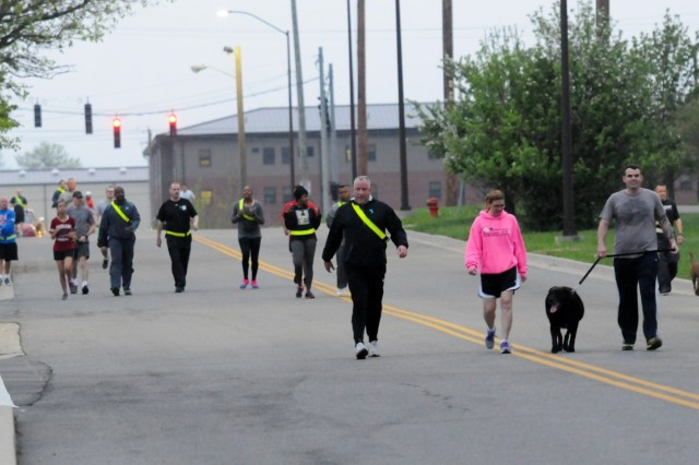 Third Sustainment Command (Expeditionary) Soldiers, families, and friends participate in the unit's 2015 Sexual Harassment/Assault Response and Prevention two-mile Fun Run/Walk, April 17, near Harris Hall. April is Sexual Assault Awareness and Prevention Month. (U.S. Army photo by Staff Sgt. Justin A. Silvers, 3rd ESC Public Affairs)