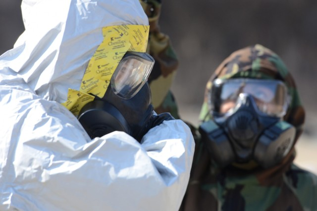 Staff Sgt. Rolando Contreras, a sample team leader in 501st Chemical, Biological, Radiological, Nuclear, Radiological Technical Escort Company, 23rd Chemical, Biological, Radiological, Nuclear and Explosive Ordnance Battalion, 1st Armored Brigade Combat Team, 2nd Infantry Division, goes through the decontamination process during training at Rodriguez Live Fire Complex, South Korea, March 25, 2015.