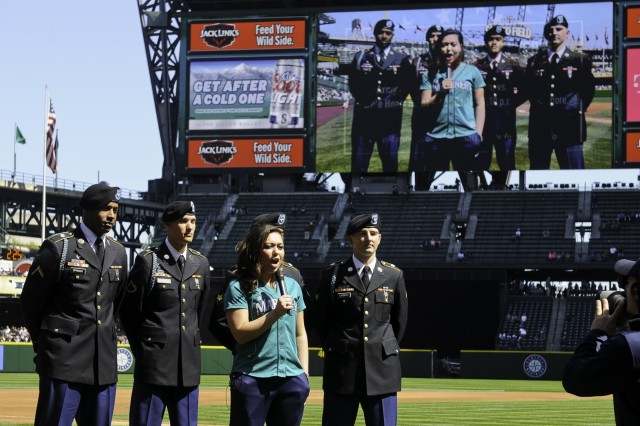 Soldiers from 1st Battalion, 17th Infantry Regiment, 2nd Stryker Brigade Combat Team, 2nd Infantry Division are interviewed during the pre-game ceremonies before the 14th Annual Seattle Mariners 'Salute to Armed Forces Day' game April 19. The Mariners host this day as a small token of appreciation for the dedication and sacrifice of all the service members.