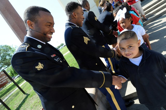 Soldier Show cast members meet and greet Camelot Elementary School students