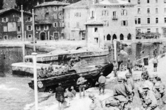 A DUKW amphibious vehicle coming ashore at Torbole, Lake Garda, April 1945.