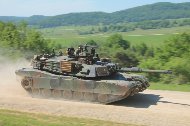 A U.S. Army M1A2 Abrams tank moves quickly toward an objective during the maneuver portion of Exercise Combined Resolve II in Hohenfels, Germany, May 2014.
