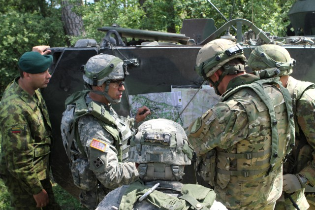 Soldiers, from the Republic of Georgia, Lithuania and the United States, discuss operations during Exercise Combined Resolve II at the Joint Multinational Readiness Center in Hohenfels, Germany, May 2014.