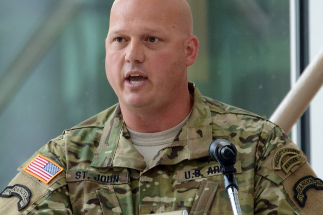 Sgt. 1st Class Jason St. John, 75th Ranger Regiment, delivers remarks during the Master Sgt. Jared Van Aalst Boulevard road dedication ceremony at Martin Army Community Hospital, April 17, 2015. (U.S. Army Photo by Sgt. 1st Class Michael R. Noggle, 75th Ranger Regiment Public Affairs NCOIC)