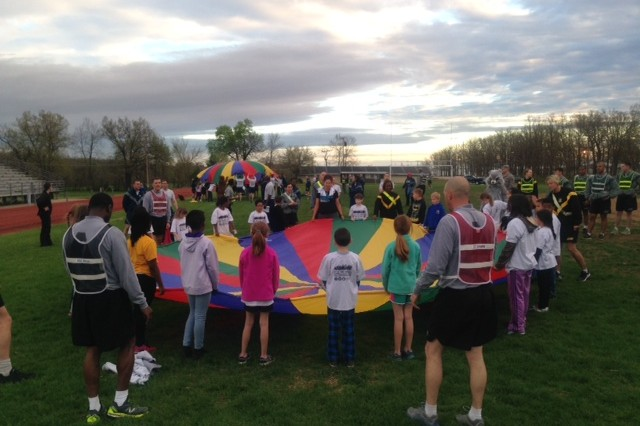 Children and their parents take part in PT in the Woods April 15.