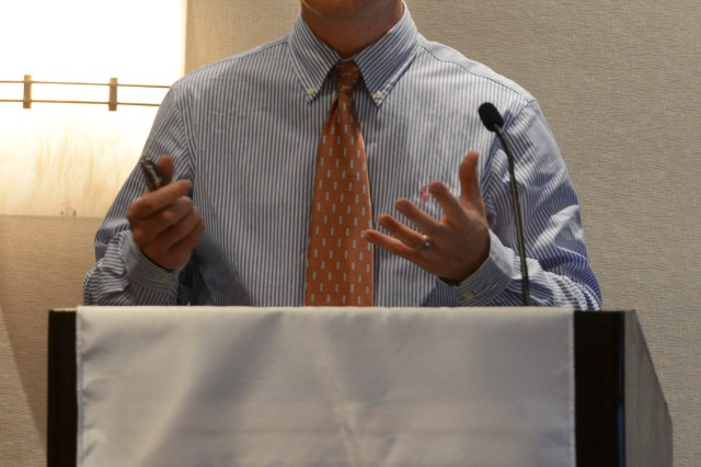 """Ralph Tillinghast, director of Collaboration and Innovation Laboratory, U.S. Army Armament Research, Development and Engineering Command, Picatinny Arsenal, N.J., addresses """"Constructing Common Fire Control Across Weapons Platforms,"""" during the National Defense Industrial Association-sponsored 2015 Armament Systems Forum, April 21, 2015."""