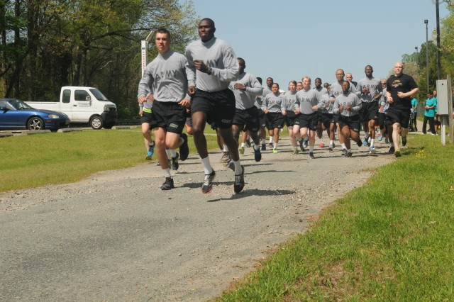 Twenty-one active duty Soldiers from P Company 244th Battalion, 23rd Quartermaster Brigade lead the way after volunteering to participate in the 80th Training Command (TASS) headquarters' third annual 5k run and walk in observance of Sexual Assault and Awareness Month at the Defense Supply Center, Richmond, Va., April 22, 2015, along with approximately 39 other participants, which included Reserve Soldiers, Department of the Army civilians and family members.