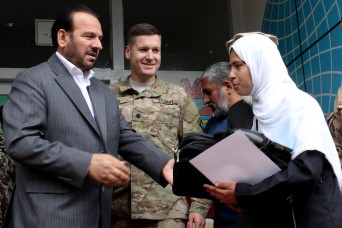 Task Force Solid Commander, Lt. Col. Zachary Miller, Parwan Provincial Governor Abdul Basir Salangi, and members from the Charikar community, gathered yesterday at the Charikar Girls High School to announce the winners of the Parwan High School Math...