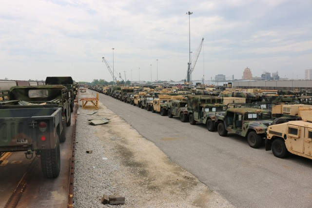 25th ID vehicles make their way from storage yard onto rail.