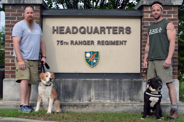 Marine veteran Dan Spangler (left) with dog Spanky and Ranger veteran Joe Trainor, Jr. with dog C.T. take a short stop at the 75th Ranger Regiment while on an epic 30-day cross country journey to raise awareness for veteran transition service.