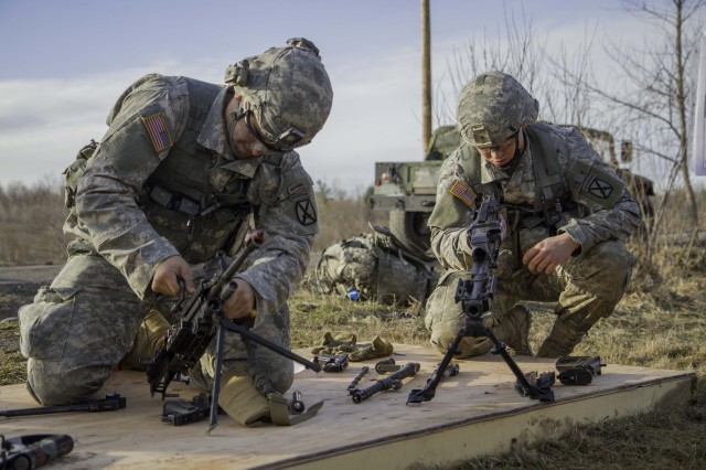 2nd Lt. Max Rossignol (L) assembles a M249 Machine Gun and 2nd Lt. Zack McClellen (R) assembles a 240B machine Gun during the weapons maintenance event for the Platoon Leaders Challenge. Both lieutenants are platoon leaders assigned to 4th Battalion, 31st Infantry Regiment, 2nd Brigade Combat Team. The challenge was conducted April 21-23 on Fort Drum to prepare the officers for their upcoming deployment to Afghanistan.