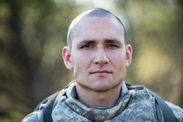 Spc. Anthony Mederos, from Tallahassee, Fla., with the 316th Engineer Company, poses for a photo while competing in the 2015 Combined Theater Engineer Commands' (TEC) Best Warrior Competition hosted at Fort McCoy, Wisconsin, April 25-29. The competition was organized and hosted by the 412th and 416th TECs, sending a total of four winners to compete at the U.S. Army Reserve Command level. (U.S. Army photo by Sgt. 1st Class Michel Sauret)