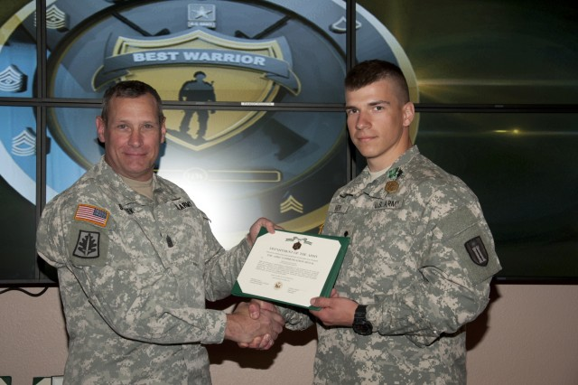 U.S. Army Reserve Spc. Ian Hagen, a Greendale, Wis., native, representing the 416th Theater Engineer Command, with the 372nd Engineer Company, Waukesha, Wis., is congratulated by Command Sgt. Major Robert Stanek, after besting other candidates to be the command's Noncommissioned Best Warrior during the 412th and 416th 2015 Combined TECs' Best Warrior Competition April 25 to 29 at Fort McCoy, Wis.  He proceeds to the U.S. Army Reserve Best Warrior Competition taking place at Fort Bragg, N.C. May 3-8. (U.S. Army photo by Sgt. 1st Class Darrin McDufford)