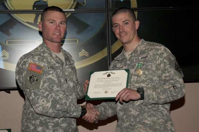 U.S. Army Reserve Cpl. Troy McFall, a Pisgah, Ala., native, representing the 412th Theater Engineer Command, with the 316th Engineer Company, Kankakee, Ill., is congratulated by 926th Engineer Brigade Command Sgt. Major Paul Yingst, after besting other candidates to be the command's Noncommissioned Best Warrior during the 412th and 416th 2015 Combined TECs' Best Warrior Competition April 25 to 29 at Fort McCoy, Wis.  He proceeds to the U.S. Army Reserve Best Warrior Competition taking place at Fort Bragg, N.C. May 3-8. (U.S. Army photo by Sgt. 1st Class Darrin McDufford)