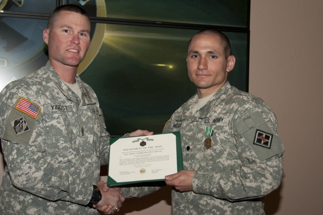 U.S. Army Reserve Spc. Anthony Mederos, a Tallahassee, Fla., native, representing the 412th Theater Engineer Command, with the 316th Engineer Company, Kankakee, Ill., is congratulated by 926th Engineer Brigade Command Sgt. Major Paul Yingst, after besting other candidates to be the command's Noncommissioned Best Warrior during the 412th and 416th 2015 Combined TECs' Best Warrior Competition April 25 to 29 at Fort McCoy, Wis. He proceeds to the U.S. Army Reserve Best Warrior Competition taking place at Fort Bragg, N.C. May 3-8. (U.S. Army photo by Sgt. 1st Class Darrin McDufford)
