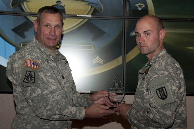 U.S. Army Reserve Staff Sgt. Jacob Simmons, a Danville, Ill., native, representing the 416th Theater Engineer Command, with the 317th Engineer Company, Kankakee, Ill., is congratulated by Command Sgt. Major Robert Stanek, after besting other candidates to be the command's Noncommissioned Best Warrior during the 412th and 416th 2015 Combined TECs' Best Warrior Competition April 25 to 29 at Fort McCoy, Wis.  He proceeds to the U.S. Army Reserve Best Warrior Competition taking place at Fort Bragg, N.C. May 3-8. (U.S. Army photo by Sgt. 1st Class Darrin McDufford)