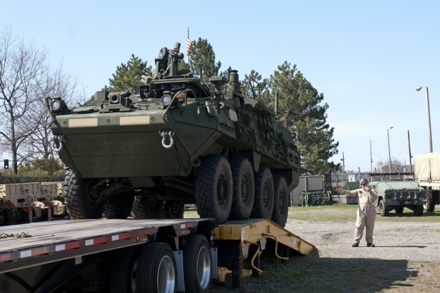 An M1135 Stryker Nuclear, Biological, Chemical, Reconnaissance vehicle is unloaded for fielding to the 401st Chemical Company in Boston, April 22. While this is the second time the company is being fielded these vehicles, they will be the first Army Reserve unit to support these vehicles logistically at their home station. (U.S. Army photo by Staff Sgt. Debralee Best)