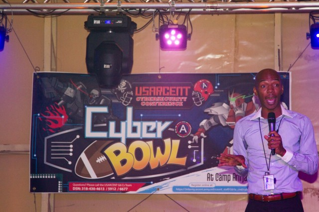 "Nate McKenzie, an information assurance officer with U.S. Army Central, speaks to attendees of the USARCENT ""Cyber Bowl"" about the ""war of tomorrow,"" April 28, 2015, on Camp Arifjan, Kuwait."