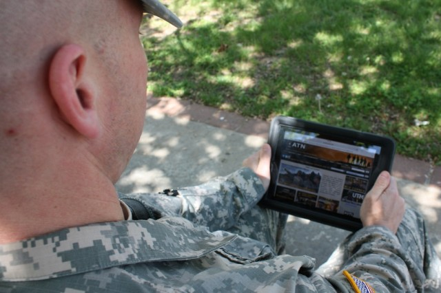 Maj. David Vodarick peruses the Army Training Network on his computer tablet. Now Soldiers can use smart phones and computer tablets to access the network, the Army's primary website for training information. Vodarick is assigned to the Training Management Directorate on Fort Leavenworth, Kan.