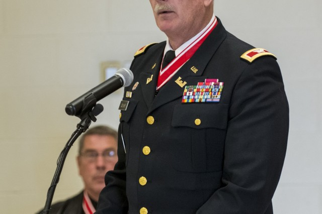 Retired Col. John Gessner, president of the Engineer Command Association, gives his remarks at the 416th Theater Engineer Command (TEC) headquarters during a Fallen Heroes Memorial Wall ceremony in Darien, Ill., May 2, to honor 46 Army Reserve Soldiers who belonged to either the 416th or 412th TEC and lost their lives while serving overseas. The ceremony was a combined effort of the two TECs and the Engineer Command Association, which funded the costs associated with the ceremony and helped organize the event. (U.S. Army photo by Sgt. 1st Class Michel Sauret)