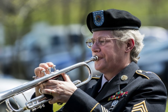 Staff Sgt. Christy Gervais, from Milwaukee, Wis., bugler with the 484th Army Band, plays taps during a Fallen Heroes Memorial Wall ceremony hosted by the 416th Theater Engineer Command (TEC) at their headquarters in Darien, Ill., May 2, to honor 46 Army Reserve Soldiers who belonged to either the 416th or 412th TEC and lost their lives while serving overseas. The ceremony was a combined effort of the two TECs and the Engineer Command Association, which funded the costs associated with the ceremony and helped organize the event. (U.S. Army photo by Sgt. 1st Class Michel Sauret)