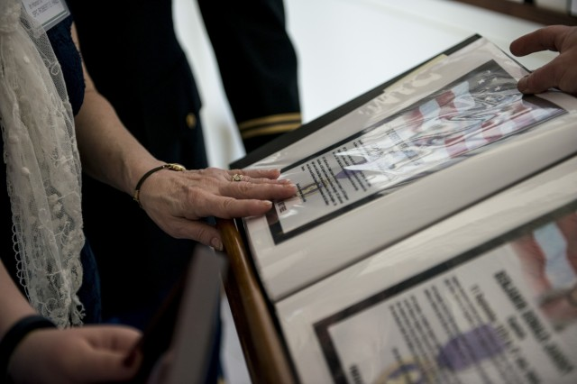 Midge Beachem, of Pittsburgh, touches the photograph of her son, Spc. Robert Hall, who died during Operation Iraqi Freedom, during a Fallen Heroes Memorial Wall ceremony at the 416th Theater Engineer Command headquarters in Darien, Ill., May 2, to honor 46 Army Reserve Soldiers who belonged to either the 416th or 412th TEC and lost their lives while serving overseas. The ceremony was a combined effort of the two TECs and the Engineer Command Association, which funded the costs associated with the ceremony and helped organize the event. (U.S. Army photo by Sgt. 1st Class Michel Sauret)