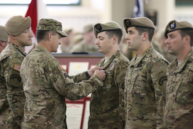 Gen. Daniel B. Allyn, Army vice chief of staff, presents the nation's third-highest award, the Silver Star, to Staff Sgt. James B. Jones for his heroic actions in support of Operations Enduring Freedom on Hunter Army Airfield in Savannah, Ga., April 29, 2015.